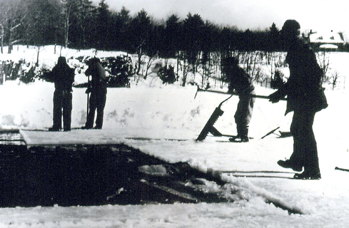 Cutting ice on Lilly Pond